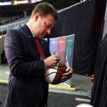 Texas Tech coach Chris Beard autographs basketballs during Big 12 NCAA college basketball media day in Kansas City, Mo., Tuesday, Oct. 25, 2016.