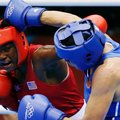 FILE - In this Aug. 9, 2012, file photo, Claressa Shields, of the United States, in red, fights Russia's Nadezda Torlopova, in blue, in a women's middleweight 75-kg boxing gold medal match at the 2012 Summer Olympics. Two-time Olympic boxing gold medalist Claressa Shields plans to make her professional debut Nov. 19 in Las Vegas. (AP Photo/Patrick Semansky, File)