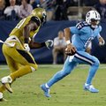 Tennessee Titans quarterback Marcus Mariota (8) scrambles away from Jacksonville Jaguars defensive tackle Malik Jackson, left, in the first half of an NFL football game Thursday, Oct. 27, 2016, in Nashville, Tenn. (AP Photo/James Kenney)