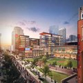 This artist rendering provided Arnold Design and the St. Louis Cardinals baseball team shows plans that were announced Tuesday, Oct. 25, 2016, for the second phase of Ballpark Village next to Busch Stadium in downtown St. Louis. It will feature a 29-story luxury apartment building, along with office, retail, restaurants and entertainment space. Construction is expected to start late next year and be completed in 2019. (Arnold Design/St. Louis Cardinals via AP)