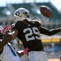 Oakland Raiders cornerback David Amerson (29) intercepts a pass intended for Jacksonville Jaguars wide receiver Marqise Lee (11) during the first quarter of an NFL football game Sunday, Oct. 23, 2016, in Jacksonville, Fla. (AP Photo/Phelan Ebenhack)