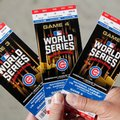 Chicago Cubs baseball fan Robert Lyons, who lives in Los Angeles and was raised in Berwyn, Ill., shows his World Series tickets outside Wrigley Field Monday, Oct. 24, 2016, in Chicago. (Michael Tercha/Chicago Tribune via AP)