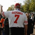 A spectator wears a jersey of Colin Kaepernick of the San Francisco 49ers before an NFL football game between Los Angeles Rams and New York Giants at Twickenham stadium in London, Sunday Oct. 23, 2016. (AP Photo/Matt Dunham)