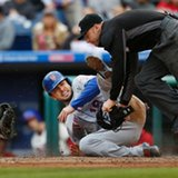 Mets beat Phillies 5-3 to clinch top NL wild card