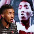 Louisville NCAA college basketball player Donovan Mitchell answers a question during the Atlantic Coast Conference media day in Charlotte, N.C., Wednesday, Oct., 26, 2016.