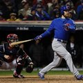 Chicago Cubs' Ben Zobrist hits an RBI triple during the fifth inning of Game 2 of the Major League Baseball World Series against the Cleveland Indians Wednesday, Oct. 26, 2016, in Cleveland. (AP Photo/David J. Phillip)
