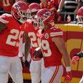 Kansas City Chiefs defensive back Eric Berry (29) congratulates defensive back Daniel Sorensen, right, after he scored a touchdown on an interception of a throw by New Orleans Saints quarterback Drew Brees, during the first half of an NFL football game in Kansas City, Mo., Sunday, Oct. 23, 2016. (AP Photo/Colin E. Braley)