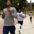 In this Sept. 28, 2016 photo, Connecticut's Terry Larrier, left, crosses the finish line during the Husky Run on the campus of the University of Connecticut, in Storrs, Conn. UConn coach Kevin Ollie is hoping his young Huskies can gel early and peak late. The American Athletic Conference tournament champions have added a highly touted recruiting class of five freshmen and VCU transfer Terry Larrier to a solid core returning from last years 25-11 squad.