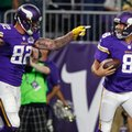 FILE - In this Sept. 18, 2016, file photo, Minnesota Vikings tight end Kyle Rudolph, left, celebrates with quarterback Sam Bradford after catching an 8-yard touchdown pass during the first half of an NFL football game against the Green Bay Packers in Minneapolis. The Vikings could not have expected a better return from the trade they made with Philadelphia for quarterback Sam Bradford, and this week Bradford and the Vikings will have the opportunity to prove as much to the Eagles. (AP Photo/Andy Clayton-King, File)