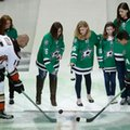 Heidi Smith, center right, wife of slain Dallas police Sgt. Michael Smith, and Emily Thompson, center left, wife of slain Dallas Area Rapid Transit officer Brent Thompson drop ceremonial pucks for Anaheim Ducks center Ryan Getzlaf (15) and Dallas Stars left wing Jamie Benn (14) before an NHL hockey game Thursday, Oct. 13, 2016, in Dallas. (AP Photo/LM Otero)