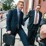 Ex-Penn State coach takes stand in whistleblower lawsuit