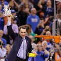 FILE - In this April 6, 2015, file photo, Duke head coach Mike Krzyzewski cuts down the net after his team's 68-63 victory over Wisconsin in the NCAA Final Four college basketball tournament championship game in Indianapolis. The parallels between this Duke team and the group from 2014-15 seem too obvious to ignore: A roster dominated by one-and-done freshmen led those Blue Devils to their fifth national title, and now a repeat of that year certainly appears possible _ maybe even likely.