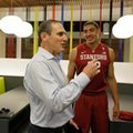 Pac-12 Commissioner Larry Scott, left, visits with Stanford forward Reid Travis, right, during NCAA college basketball Pac-12 media day Friday, Oct. 21, 2016, in San Francisco.