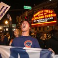 Chicago Cubs fans celebrate outside Wrigley Field after the Cubs defeated the Los Angeles Dodgers 5-0 in Game 6 of baseball's National League Championship Series, Saturday, Oct. 22, 2016, in Chicago. The Cubs advanced to the World Series. (Ashlee Rezin/Chicago Sun-Times via AP)