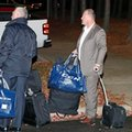 Gerard Gallant, right, former Florida Panthers head coach, waits for a cab after being relieved of his duties following an NHL hockey game against the Carolina Hurricanes, Sunday, Nov. 27, 2016, in Raleigh, N.C. (AP Photo/Karl B DeBlaker)
