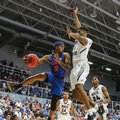 Florida guard Kasey Hill (0) passes as North Florida forward Karlos Odum (1) defends during the first half of an NCAA college basketball game in Jacksonville, Fla., Thursday, Dec. 1, 2016.