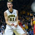 Iowa forward Nicholas Baer cheers after making a basket and being fouled during the first half of an NCAA college basketball game against Iowa State, Thursday, Dec. 8, 2016, in Iowa City, Iowa.