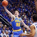 UCLA's TJ Leaf shoots near Kentucky's Isaiah Briscoe during the second half of an NCAA college basketball game, Saturday, Dec. 3, 2016, in Lexington, Ky. UCLA upset No. 1 Kentucky 97-92.