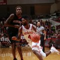 Indiana guard Robert Johnson (4) goes around Southeast Missouri State guard Antonius Cleveland (1) in the second half of an NCAA college basketball game in Bloomington, Ind., Sunday, Dec. 4, 2016. Indiana won 83-55.