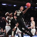 Purdue forward Vince Edwards (12) goes up for a shot against Arizona State in the second half of an NCAA college basketball game, Tuesday, Dec. 6, 2016, in New York. Purdue won 97-64.