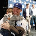 Los Angeles Dodgers pitcher Rich Hill hugs his son Brice Hill, age 5, after a media availability at Major League Baseball's winter meetings, Monday, Dec. 5, 2016 in Oxon Hill, Md. (AP Photo/Alex Brandon)