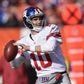 FILE - In this Sunday, Nov. 27, 2016 file photo, New York Giants quarterback Eli Manning throws in the first half of an NFL football game against the Cleveland Browns in Cleveland. The Giants vs. the Steelers. Or sometimes referred to as the Maras against the Rooneys for their family business roots. They meet in a huge game Sunday, Dec. 4, 2016. (AP Photo/David Richard, File)