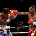 Panama's Luis Concepcion, left, in action against Britain's Kal Yafai during their Vacant WBA Super-Flyweight Championship bout at the Manchester Arena, England, Saturday, Dec. 10, 2016. (Peter Byrne/PA via AP)