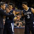 Villanova's head coach Jay Wright, left, talks thing over with Josh Hart, right, as Jalen Brunson, center listens in during the second half of an NCAA basketball game against La Salle, Tuesday, Dec. 6, 2016, in Philadelphia. Villanova won 89-79.