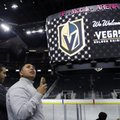 FILE - In this Nov. 22, 2016, file photo, people tour T-Mobile Arena during an event to unveil the name of Las Vegas' National Hockey League franchise, in Las Vegas. The U.S. Patent and Trademark Office has denied the Vegas Golden Knights' trademark application a little more than two weeks after the new NHL franchise unveiled its name and logo. The office cites potential confusion with the team name for the College of Saint Rose in New York, which is also the Golden Knights. (AP Photo/John Locher, File)