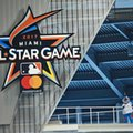 FILE - In this Wednesday, July 27, 2016, file photo, Miami Marlins mascot Billy the Marlin waves after unveiling the official logo for the 2017 All-Star Game that will be held in Miami, during a ceremony before the start of a baseball game between the Miami Marlins and the Philadelphia Phillies in Miami. The league that wins baseball's All-Star Game no longer will get home-field advantage in the World Series, which instead will go to the pennant winner with the better regular-season record. The change was included in Major League Baseball's tentative new collective bargaining agreement and disclosed early Thursday, Dec. 1, to The Associated Press by a person familiar with the agreement. The person spoke on condition of anonymity because details of the deal, reached Wednesday evening in Irving, Texas, had not been announced. (AP Photo/Wilfredo Lee, File)