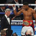 Britain's IBF Heavyweight champion Anthony Joshua has his hand raised by ring announcer Michael Buffer after beating American Eric Molina in Manchester, England, Saturday, Dec. 10, 2016. (AP Photo/Dave Thompson)