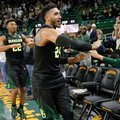Baylor's Ishmail Wainright (24) and King McClure (22) lead teammates around the arena as they celebrate with fans after their 76-61 win over Xavier in an NCAA college basketball game, Saturday, Dec. 3, 2016, in Waco, Texas.