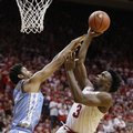 Indiana's OG Anunoby (3) shoots against North Carolina's Isaiah Hicks during the second half of an NCAA college basketball game Wednesday, Nov. 30, 2016, in Bloomington, Ind. Indiana defeated North Carolina 76-67.