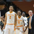 Tennessee's Grant Williams (2), Kyle Alexander (11) and coach Rick Barnes react after Robert Hubbs III (3) made a 3-pointer against Mississippi State during an NCAA college basketball game in Knoxville, Tenn., Saturday, Jan. 21, 2017.
