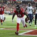 Atlanta Falcons wide receiver Julio Jones scores a touchdown against the Seattle Seahawks during the first quarter of an NFL football NFC divisional playoff game Saturday, Jan. 14, 2017, in Atlanta. (Curtis Compton/Atlanta Journal-Constitution via AP)