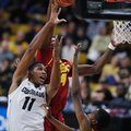 Colorado guard Xavier Johnson, left, goes up for a basket as USC forward Chimezie Metu, center, and guard Shaqquan Aaron, right, defend in the second half of an NCAA college basketball game Sunday, Jan. 15, 2017, in Boulder, Colo. USC won 71-68.