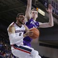 Gonzaga guard Nigel Williams-Goss, left, is fouled by Portland center Philipp Hartwich during the second half of an NCAA college basketball game in Spokane, Wash., Saturday, Jan. 21, 2017. Gonzaga won 73-52.