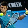 Serbia's Novak Djokovic makes a backhand return during a practice session ahead of the Australian Open tennis championships in Melbourne, Australia, Sunday, Jan. 15, 2017. (AP Photo/Aaron Favila)
