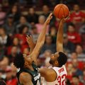 Ohio State center Trevor Thompson, right, goes up to shoot against Michigan State forward Nick Ward during the first half of an NCAA college basketball game in Columbus, Ohio, Sunday, Jan. 15, 2017.