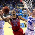 Arizona guard Allonzo Trier, center, shoots as UCLA guard Lonzo Ball, left, and center Thomas Welsh defend during the second half of an NCAA college basketball game, Saturday, Jan. 21, 2017, in Los Angeles. Arizona won 96-85.