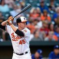 FILE - In this Aug. 3, 2016, file photo, Baltimore Orioles' Mark Trumbo bats during the team's baseball game against the Texas Rangers in Baltimore. A person familiar with the negotiations says the Orioles have agreed to a $37.5 million, three-year contract to keep Trumbo. The person spoke to The Associated Press on condition of anonymity Thursday night, Jan. 19, because the agreement is contingent on Trumbo passing a physical. (AP Photo/Nick Wass, File)