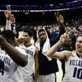 Villanova's Donte DiVincenzo, from right, Kris Jenkins, Josh Hart and Eric Paschall celebrate after an NCAA college basketball game against Marquette, Saturday, Jan. 7, 2017, in Philadelphia. Villanova won 93-81.
