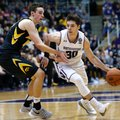 Northwestern guard Bryant McIntosh, right, drives against Iowa forward Nicholas Baer during the second half of an NCAA college basketball game Sunday, Jan. 15, 2017, in Evanston, Ill. Northwestern won 89-54.