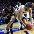 West Virginia forward Nathan Adrian (11) gets to a loose ball ahead of Kansas State guard Barry Brown (5) during the first half of an NCAA college basketball game in Manhattan, Kan., Saturday, Jan. 21, 2017.