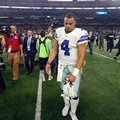 Dallas Cowboys quarterback Dak Prescott (4) walks off the field after losing to the Green Bay Packers in an NFL divisional playoff football game Sunday, Jan. 15, 2017, in Arlington, Texas. The Packers won 34-31. (AP Photo/Michael Ainsworth)