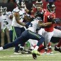 Seattle Seahawks cornerback Richard Sherman (25) tackles Atlanta Falcons wide receiver Julio Jones (11) during the second half of an NFL football divisional football game, Saturday, Jan. 14, 2017, in Atlanta. (AP Photo/John Bazemore)