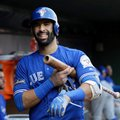 FILE - In this Oct. 6, 2016, file photo, Toronto Blue Jays' Jose Bautista smiles as he walks through the dugout during Game 1 of the team's American League Division Series against the Texas Rangers in Arlington, Texas. A person with knowledge of the negotiations tells The Associated Press that free agent outfielder Jose Bautista is staying with the Toronto Blue Jays after agreeing to an $18 million, one-year contract with mutual options for more years. (AP Photo/LM Otero, File)