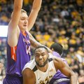 Wichita State center Shaquille Morris tries to squeeze through Evansville center Sergej Vucetic , left, and forward Solomon Hainna during the first half of an NCAA college basketball game Tuesday, Feb. 21, 2017, in Wichita, Kan.