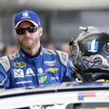 FILE - In this Saturday, May 28, 2016 file photo, Dale Earnhardt Jr. waits in the garage prior to practice for Sunday's NASCAR Sprint Cup Series auto race at the Charlotte Motor Speedway in Concord, N.C. Dale Earnhardt Jr. is often the center of attention at the Daytona 500, where he has won twice. But things are different this year. All those cheers for NASCAR's most popular driver have been joined by fears about his health. He missed the last half of last season because of a concussion. He says he is fully healthy, but the real test will be the first head-jarring crash in his car. The season-opening race is Sunday, Feb. 26, 2017.(AP Photo/Gerry Broome)