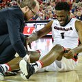 Georgia forward Yante Maten, right, is tended to by personnel during the first half of an NCAA basketball game against Kentucky, Saturday, Feb. 18, 2017, in Athens, Ga. Kentucky won 82-77. Maten was taken out of the game for the injury.